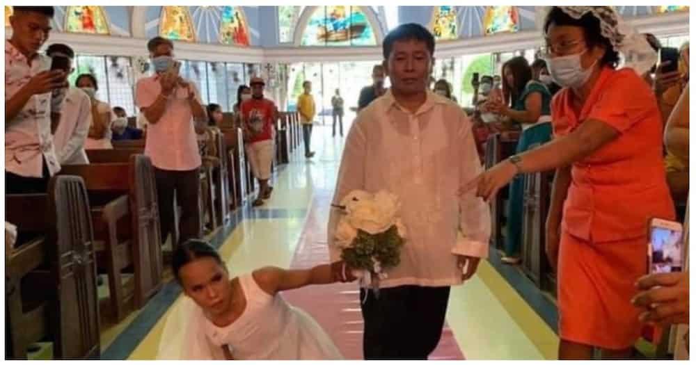 Bride na hirap maglakad, pinasan na ng groom matapos ang kanilang kasalan