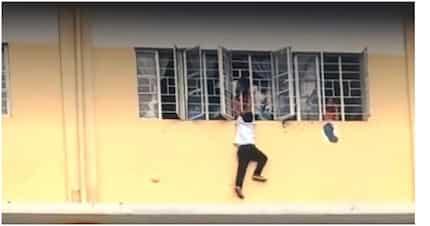 Viral ang video ng isang estudyante na halos mahulog sa building ng eskwelahan