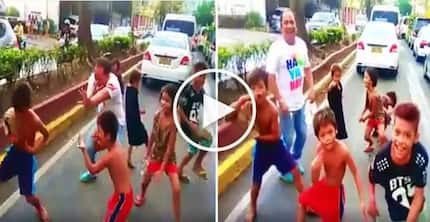 This Pinoy car passenger in Cebu danced with hilarious street children while stuck in heavy traffic!