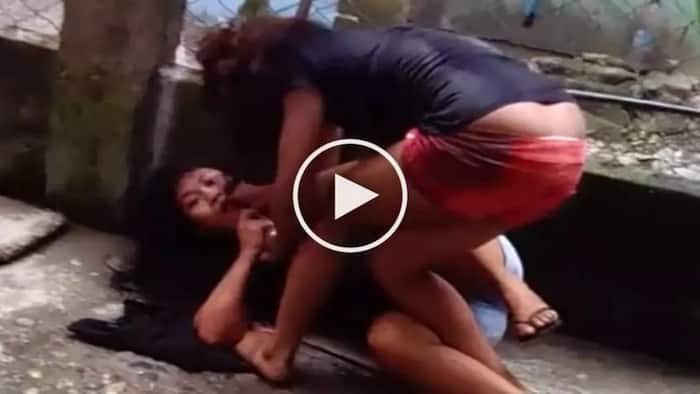 Furious woman is brutally beating her helpless female neighbor