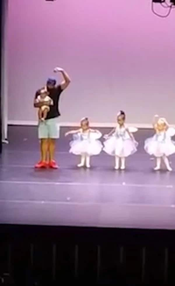 Father rescues daughter from stage fright by getting on stage and doing ballet himself