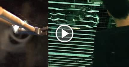 Slow-motion 120 000 fps video of hammer smashing a mirror reveals something truly amazing