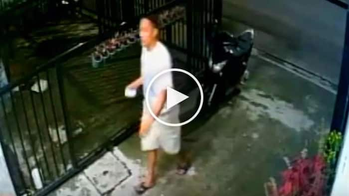 Dangerous Pinoy hold-upper robs scared customers in Quezon City laundry shop