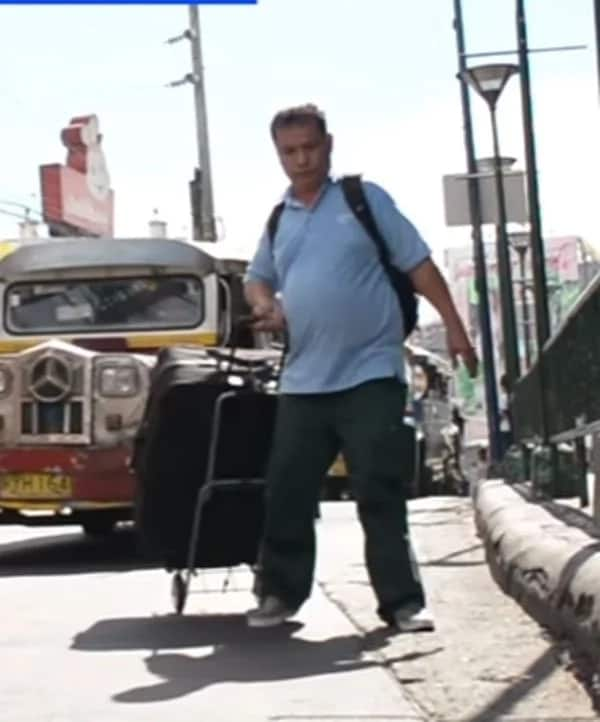 Half-paralyzed father sells candies in Makati to send children to school