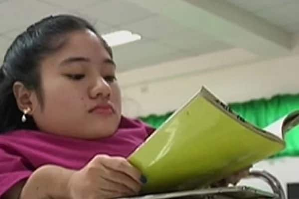 Girl from Davao with bone disease graduates 'magnacumlaude'