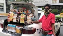 Driver na ginawang tindahan ang kanyang taxi, umantig sa mga netizens