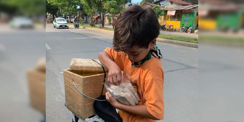 """Kid vendor earns praises; refuses to accept """"ayuda"""" money but urged people to buy his fresh lumpia"""