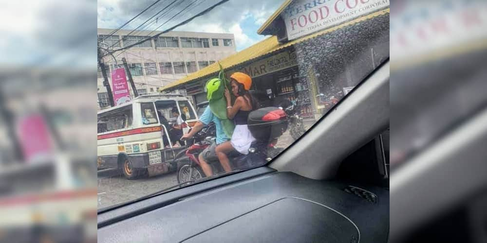 Couple who use banana leaves as substitute for motorcycle barrier goes viral