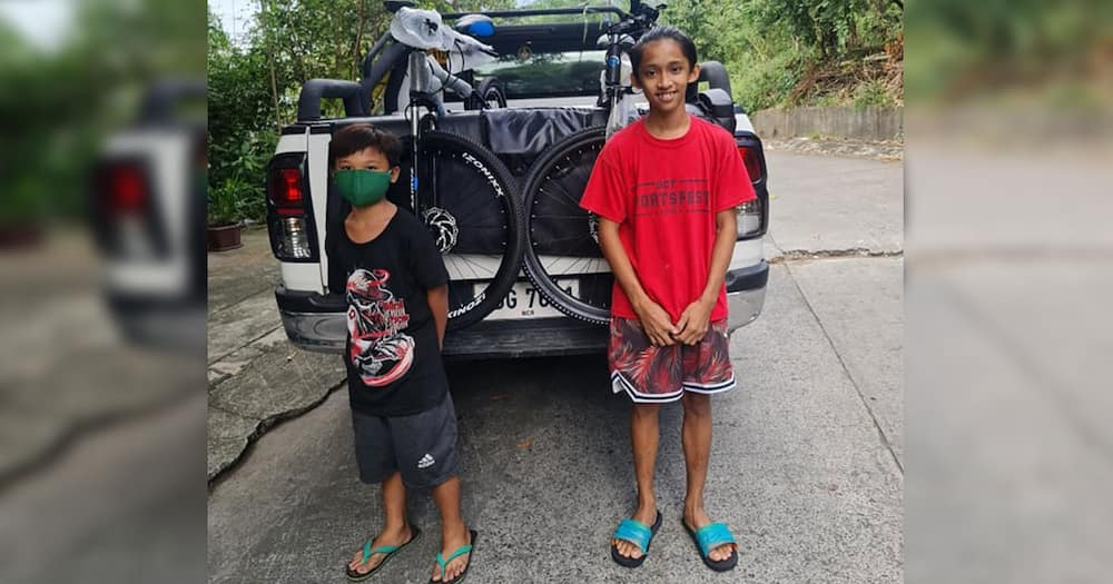 Two young construction helpers carry rocks to save for a bicycle; receive brand new ones
