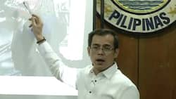 Mayor Isko Moreno shows photos of persons of interest in Binondo bank robbery