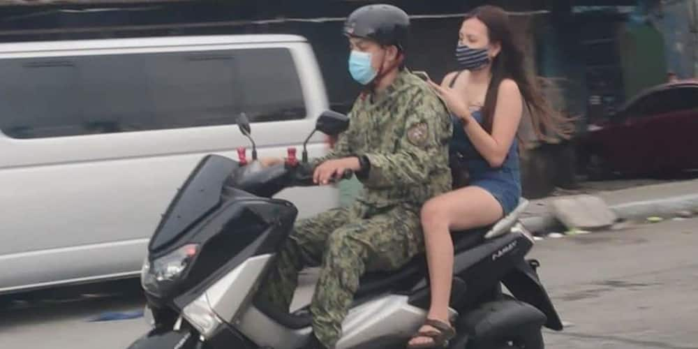 Photo of cop on a motorcycle with helmet-less backrider but no barrier installed goes viral