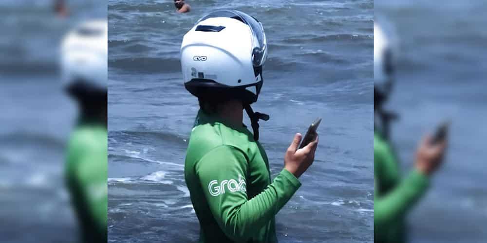 Grab rider ends up wading at sea because of customer's pin location on app