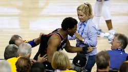 Toronto's Kyle Lowry gets shoved by Warriors' part-owner Mark Stevens