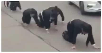 Video ng mga empleyadong pinagapang sa kalsada bilang parusa, kinagalit ng netizens