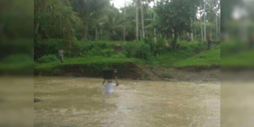 Teacher crosses dangerous rivers to bring modules to students in remote areas