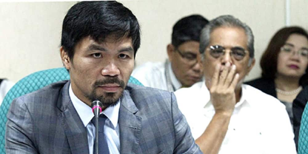 Manny Pacquiao hands out cash and groceries to Typhoon Ulysses victims